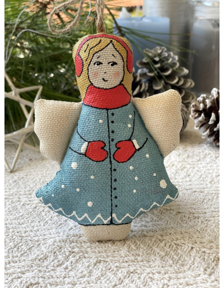 Angel doll with a red scarf