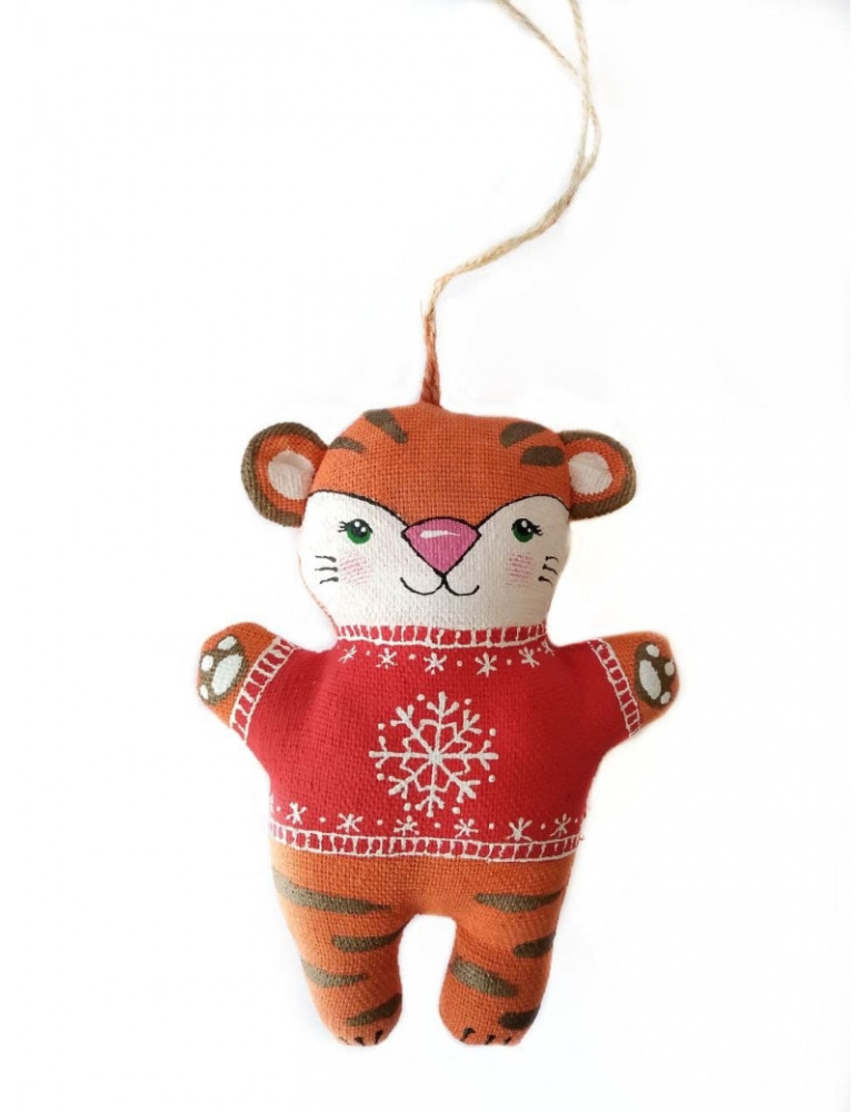 Symbol of the year 2022 Tiger in a red sweater with a snowflake