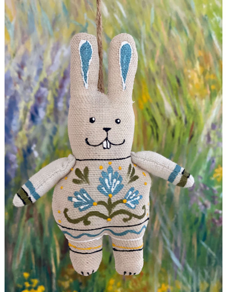 Hare with paws with blue flowers